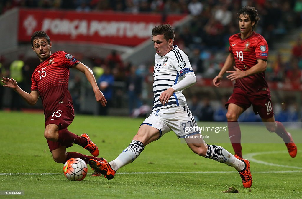 Denmark's Pierre Hojbjerg with Portugal's midfielder Bernardo Silva in action during the UEFA EURO 2016 Qualifier match between Portugal and Denmark at Estadio Municipal de Braga on October 8, 2015 in Braga Portugal.