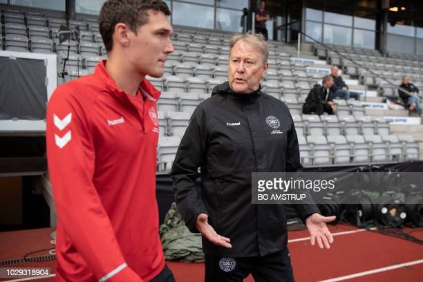 Denmark's player Andreas Christensen and coach Aage Hareide arrive for a training session on the eve of the Nations League football match between...