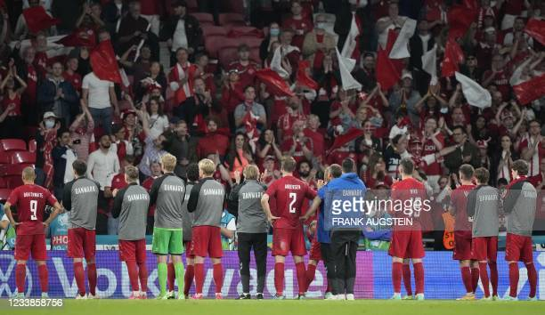 Denmark's players applaud in front of their supporters at the end of the UEFA EURO 2020 semi-final football match between England and Denmark at...