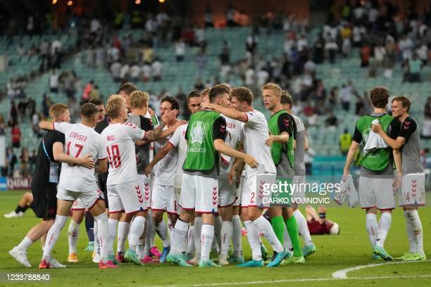 Denmark's players celebrate after winning the UEFA EURO 2020 quarter-final football match between the Czech Republic and Denmark at the Olympic...
