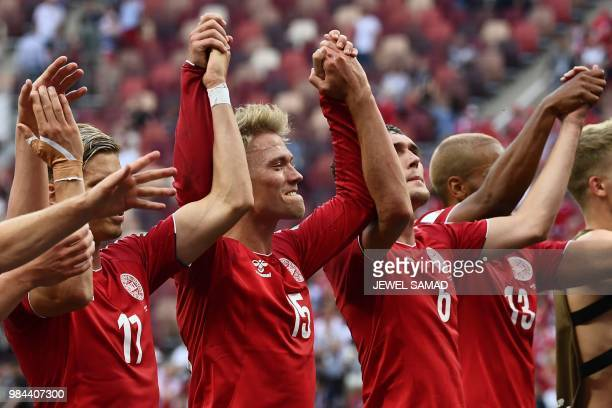 Denmark's players celebrate at the end of the Russia 2018 World Cup Group C football match between Denmark and France at the Luzhniki Stadium in...