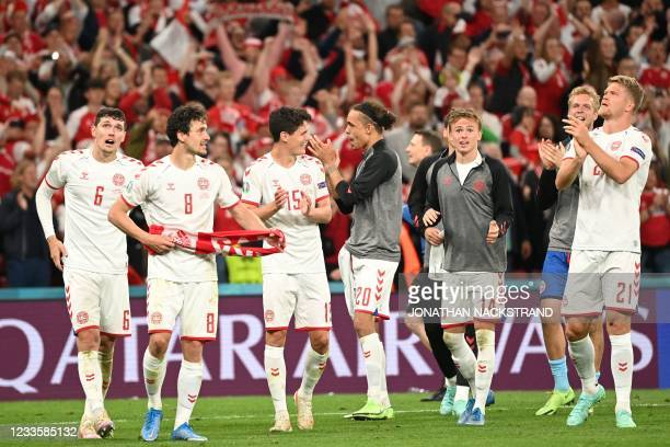 Denmark's players celebrate at the end of the UEFA EURO 2020 Group B football match between Russia and Denmark at Parken Stadium in Copenhagen on...