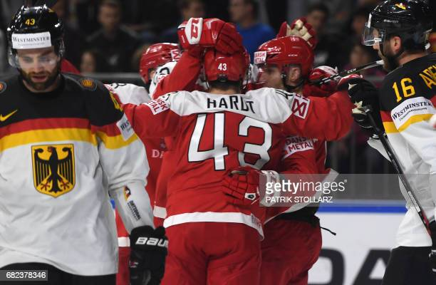 Denmark's players celebrate during the IIHF Ice Hockey World Championships first round match between Denmark and Germany in Cologne western Germany...