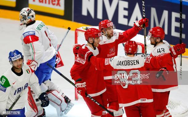 Denmark´s players celebrate scoring during the IIHF Men's World Championship Ice Hockey match between Denmark and Italy in Cologne western Germany on...