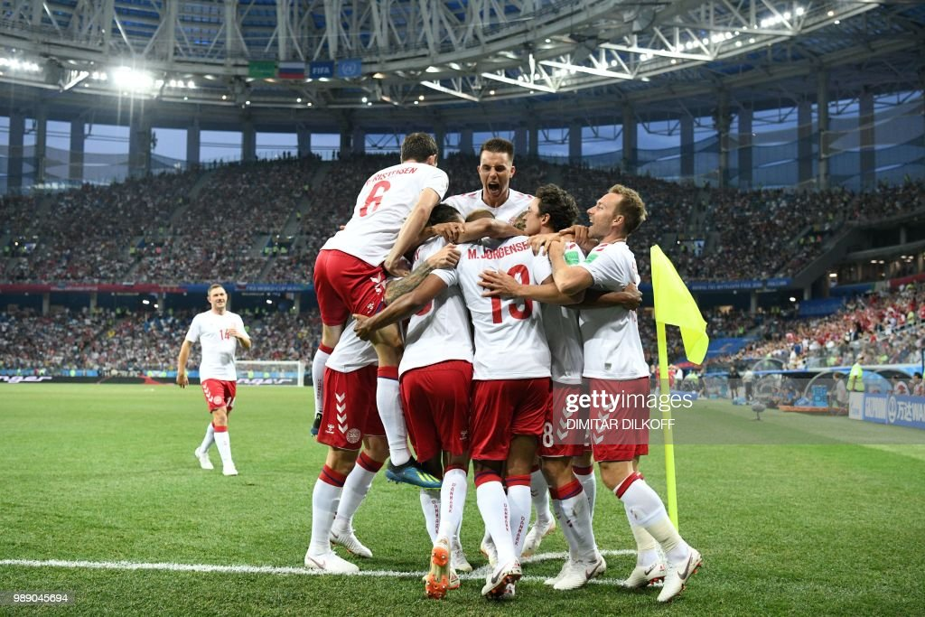 TOPSHOT - Denmark's players celebrate the opening goal during the Russia 2018 World Cup round of 16 football match between Croatia and Denmark at the Nizhny Novgorod Stadium in Nizhny Novgorod on July 1, 2018. (Photo by Dimitar DILKOFF / AFP) / RESTRICTED
