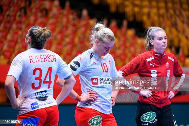 Denmark's players, Denmark's Pivot Rikke Iversen and Denmark's Pivot Kathrine Heindahl and Denmark's Goalkeeper Althea Reinhardt react after the...