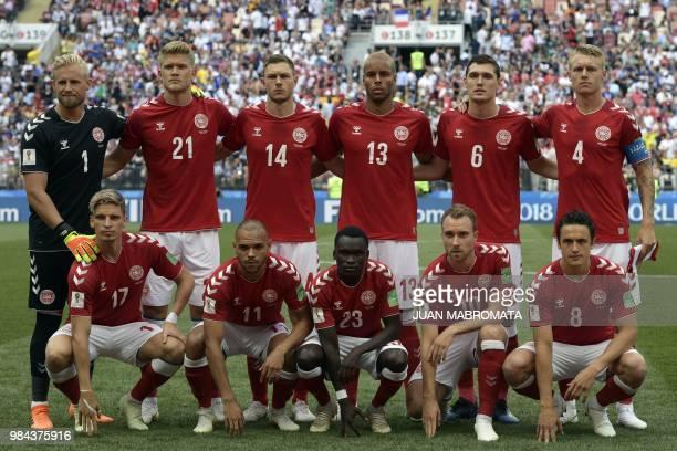 Denmark's players goalkeeper Kasper Schmeichel, forward Andreas Cornelius, defender Henrik Dalsgaard, defender Mathias Jorgensen, defender Andreas...