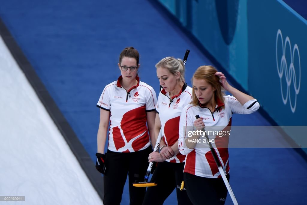 Denmark's players react during the curling women's round robin session between South Korea and Denmark during the Pyeongchang 2018 Winter Olympic Games at the Gangneung Curling Centre in Gangneung on February 21, 2018. / AFP PHOTO / WANG Zhao