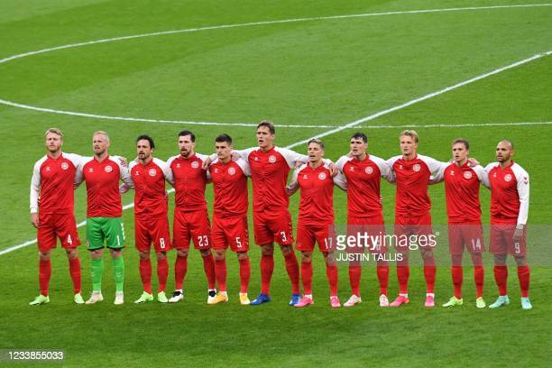 Denmark's players sing their national anthem ahead of the UEFA EURO 2020 semi-final football match between England and Denmark at Wembley Stadium in...