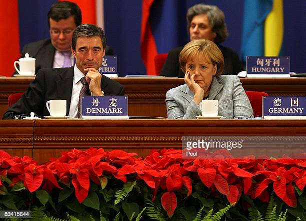 Denmark's Prime Minister Anders Fogh Rasmussen, and German Chancellor Angela Merkel attends the Opening ceremony for the 7th Asia Europe Meeting...
