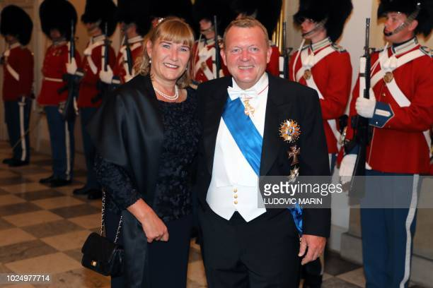 Denmark's Prime Minister Lars Lokke Rasmussen and his wife Solrun arrive for the state dinner at Christiansborg Palace in Copenhagen on August 28,...