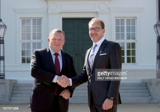 Denmark's Prime Minister Lars Lokke Rasmussen and the deputy parliamentary group leader of the conservative CDU/CSU faction Alexander Dobrindt shake...