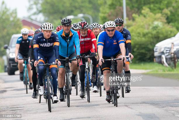 Denmarks Prime Minister Lars Lokke Rasmussen campaigns on a bike ride with local candidates over 40 km near Vejle in Jutland, Denmark, on May 24,...