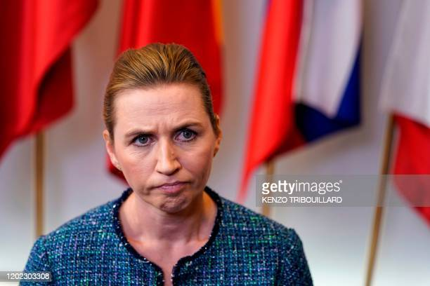 Denmark's Prime Minister Mette Frederiksen addresses the press ending the second day of the special European Council summit in Brussels on February...
