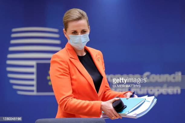 Denmark's Prime Minister Mette Frederiksen arrives for a round table meeting at an EU summit at the European Council building in Brussels on December...