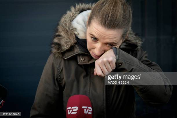 Denmark's Prime Minister Mette Frederiksen reacts as she meets journalists after visiting a closed and empty mink farm near Kolding Denmark on...