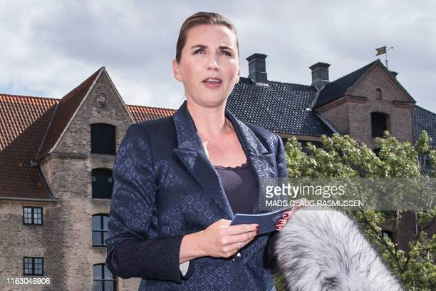 Denmark's Prime Minister Mette Frederiksen talks to the press after US President cancelled his state visit after her government said its territory...