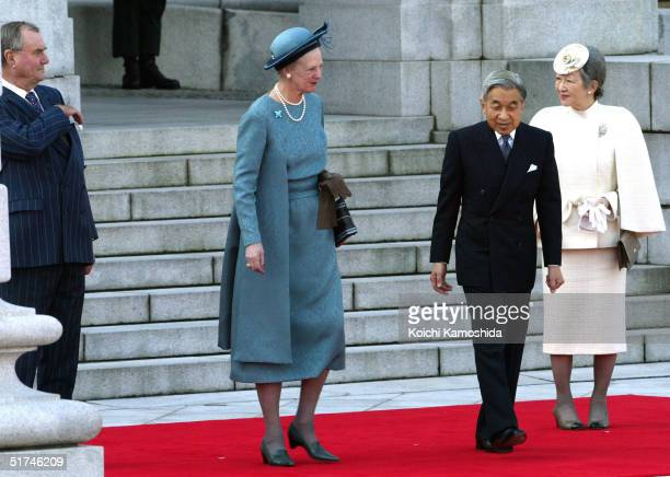 Denmark's Prince Consort Henrik and Queen Margrethe II, and Japan's Emperor Akihito and Empress Michiko attend a welcome ceremony at the Akasaka...