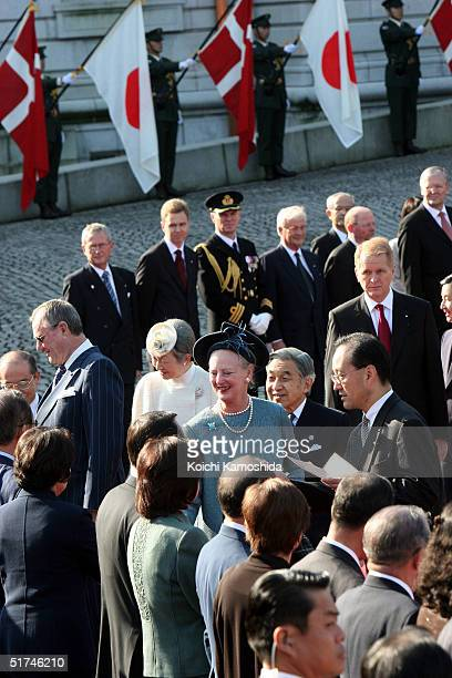 Denmark's Prince Consort Henrik and Queen Margrethe II and Japan's Emperor Akihito and Empress Michiko attend a welcome ceremony at the Akasaka state...