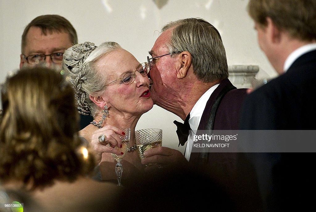 Denmark's Prince Consort Henrik (R) kiss : News Photo