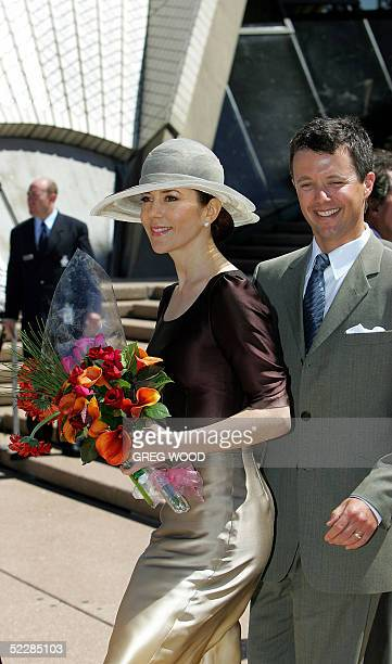 Denmark's Prince Frederik and Princess Mary, pose on the steps of the Sydney Opera House, 07 March 2005, following a function to announce the new...