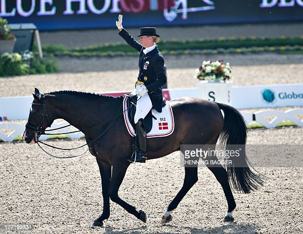 Denmark's Princess Nathalie zu SaynWittgenstein waves after competing on the horse Digby during the FEI Dressage European Championships in Herning...