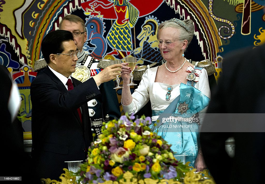 Denmark's Queen Margrethe (R) and China's President Hu Jintao take part in an official state banquet at Christiansborg Palace in Copenhagen on June 15, 2012.