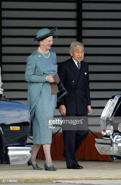 Denmark's Queen Margrethe II and Japan's Emperor Akihito appear at the entrance of Imperial Palace November 16 2004 in Tokyo Japan HM Queen Margrethe...