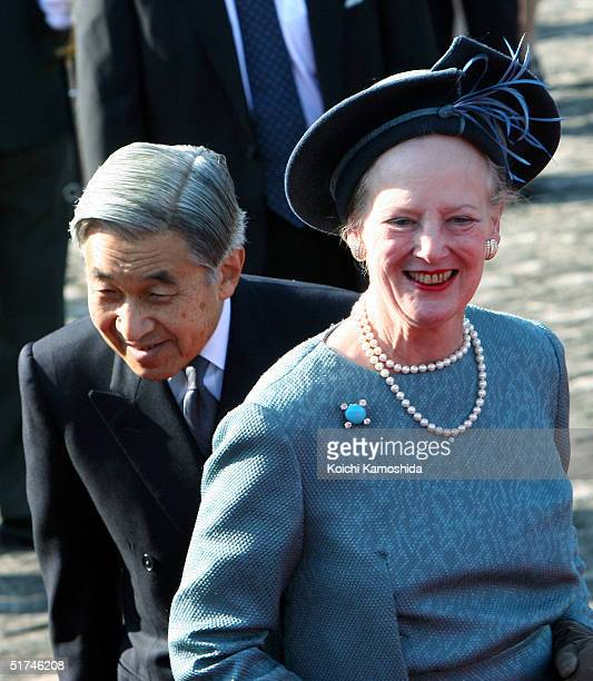 Denmark's Queen Margrethe II and Japan's Emperor Akihito attend a welcome ceremony at the Akasaka state guest house November 16 2004 in Tokyo Japan...