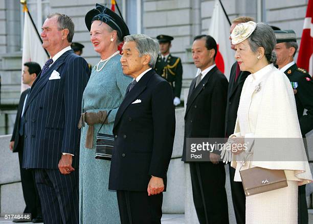 Denmark's Queen Margrethe II and Prince Consort Henrik listen to the national anthem with Japan's Emperor Akihito and Empress Michiko during the...