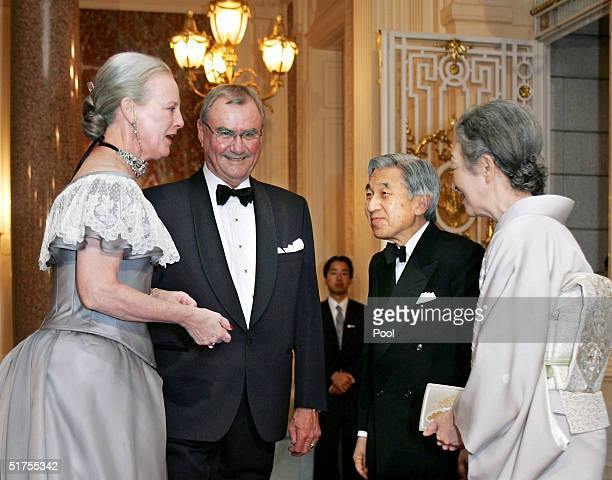 Denmark's Queen Margrethe II and Prince Consort Henrik welcome Emperor Akihito and Empress Michiko of Japan as they arrive for a return reception by...