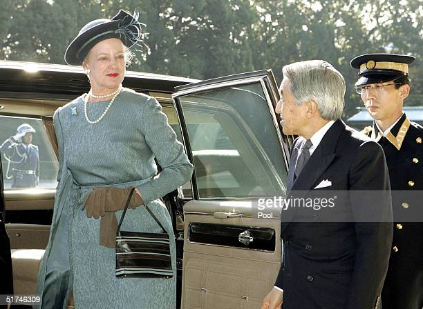 Denmark's Queen Margrethe II arrives at the Imperial Palace with Japanese Emperor Akihito after her welcoming ceremony November 16 2004 in Tokyo...