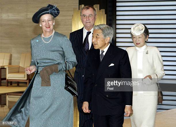 Denmark's Queen Margrethe II chats with Japanese Emperor Akihito as they leave the Imperial Palace followed by Prince Consort Henrik and Empress...