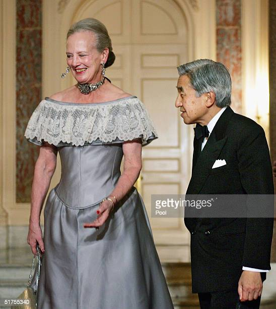 Denmark's Queen Margrethe II leads Emperor Akihito of Japan into the Akasaka state guesthouse as they arrive for a return reception by the Danish...