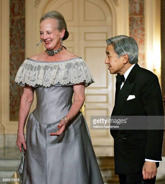 Denmark's Queen Margrethe II leads Emperor Akihito of Japan into the Akasaka state guesthouse as the monarch arrives for a return reception hosted by...