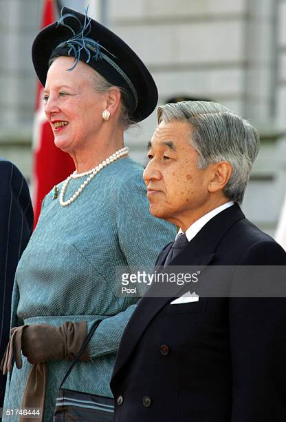 Denmark's Queen Margrethe II listens to the national anthem with Japan's Emperor Akihito during the welcoming ceremony at the Akasaka state guest...