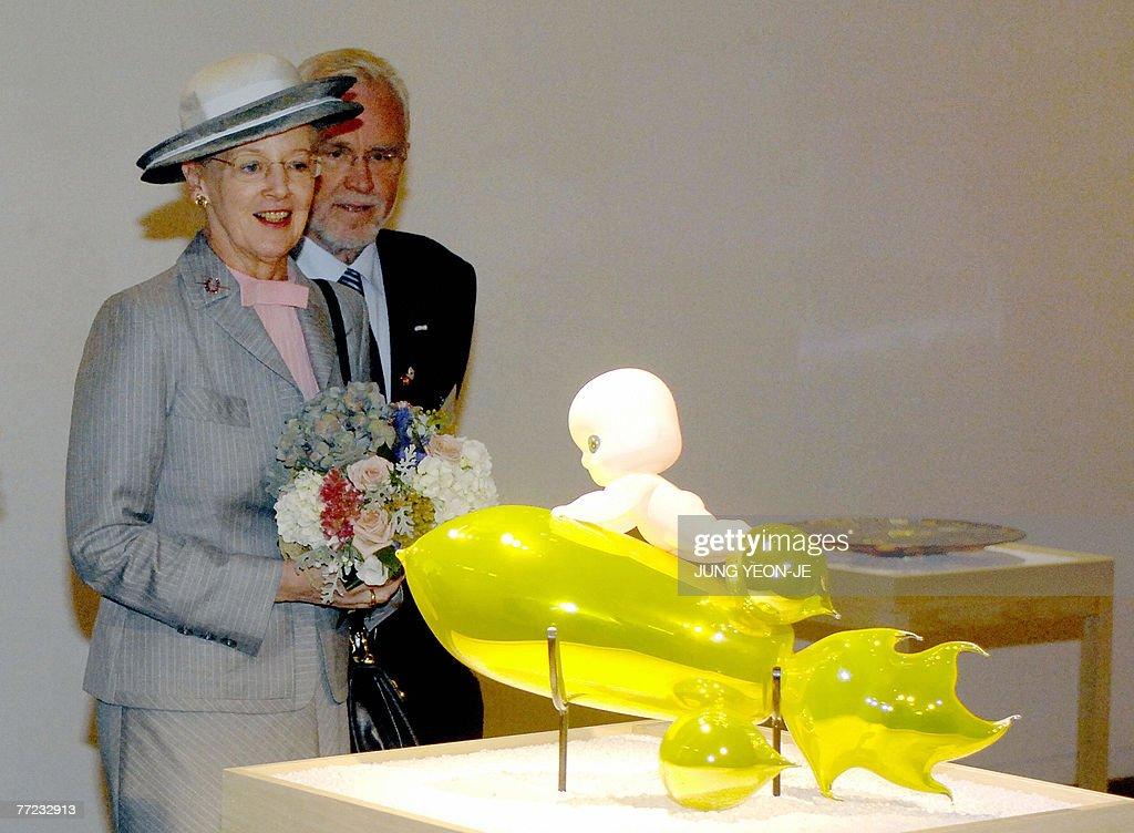 Denmark's Queen Margrethe II (L) looks a : News Photo