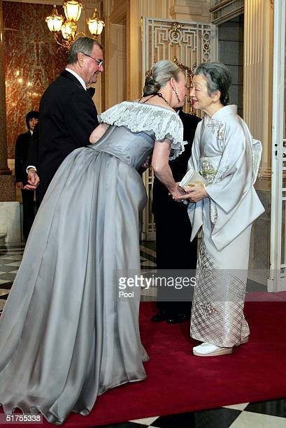 Denmark's Queen Margrethe II welcomes Empress Michiko and Emperor Akihito with Prince Consort Henrik on their arrival at a return reception at the...