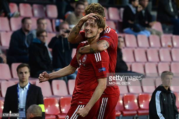 Denmark's Rasmus Falk celebrates with his teammate Alexander Scholzafter scoring during final tournament of the UEFA Under21 European Championship...