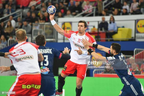 Denmark's Rasmus Lauge Schmidt passes the ball under pressure from France's Nedim Remili during the match for third place of the Men's 2018 EHF...