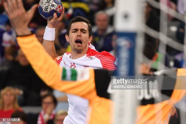 Denmark's Rasmus Lauge Schmidt shoots on goal during the match for third place of the Men's 2018 EHF European Handball Championship between France...