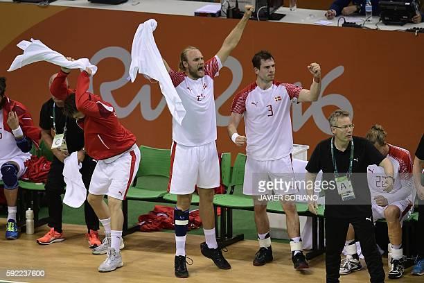 Denmark's right back Kasper Sondergaard Denmark's right back Mads Christiansen and Denmark's coach Gudmundur Gudmundsson celebrate a goal during the...