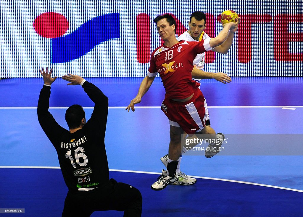 Denmark's right wing Hans Lindberg (up) vies with Macedonia's goalkeeper Borko Ristovski (L) during the 23rd Men's Handball World Championships preliminary round Group B match Denmark vs Macedonia at the Palacio de Deportes San Pablo in Sevilla on January 18, 2013.
