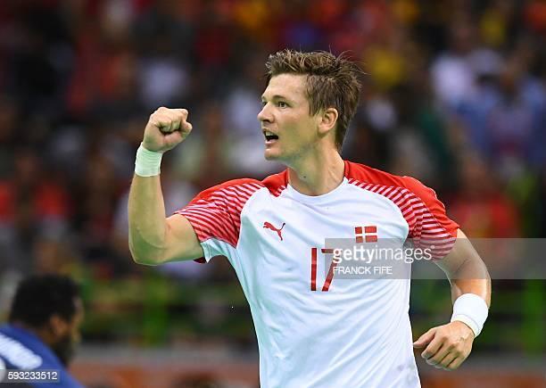 Denmark's right wing Lasse Svan celebrates a goal during the men's Gold Medal handball match Denmark vs France for the Rio 2016 Olympics Games at the...