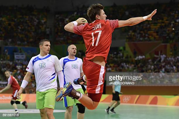 TOPSHOT Denmark's right wing Lasse Svan jumps to shoot during the men's quarterfinal handball match Denmark vs Slovenia for the Rio 2016 Olympics...