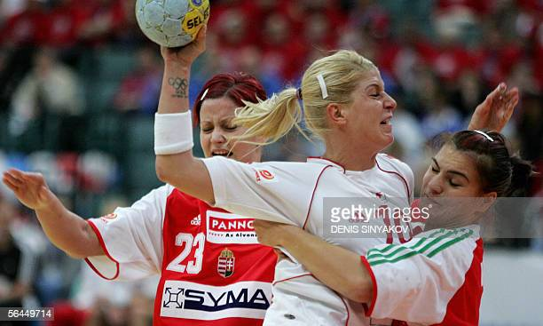 Denmark's Rikke Horlykke Jorgensen attacks as Hungary's Orsolya Verten and Gabriella Szucs tries to stop her during their handball match for the...