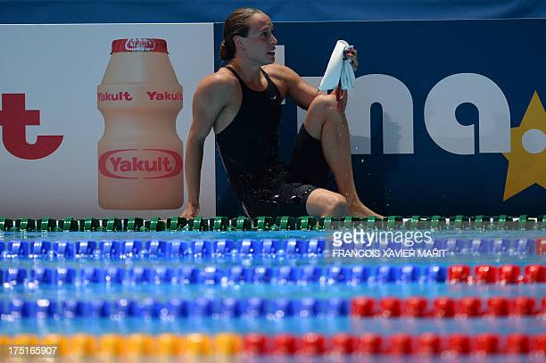 Denmark's Rikke Moller Pedersen leaves the swimming pool after breaking the women's 200m breaststroke record during the semifinals of the women's...