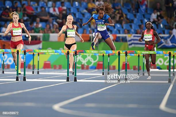 Denmark's Sara Slott Petersen Canada's Sage Watson USA's Dalilah Muhammad and Trinidad and Tobago's Janeil Bellille compete in the Women's 400m...