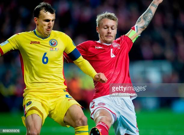 Denmark's Simon Kjaer vies with Romania's Vlad Chiriches during the FIFA World Cup 2018 qualification football match between Denmark and Romania in...