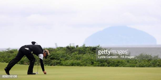 Denmark's Soren Kjeldsen with Ailsa Craig Island in the background during the third round of the Open Championship 2009 at Turnberry Golf Club...